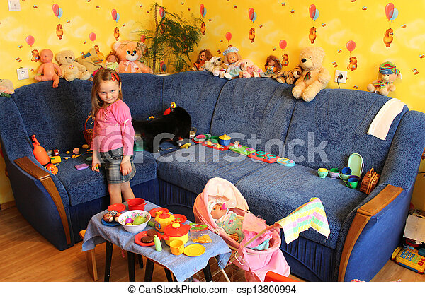 little girl playing with toys in her room - csp13800994