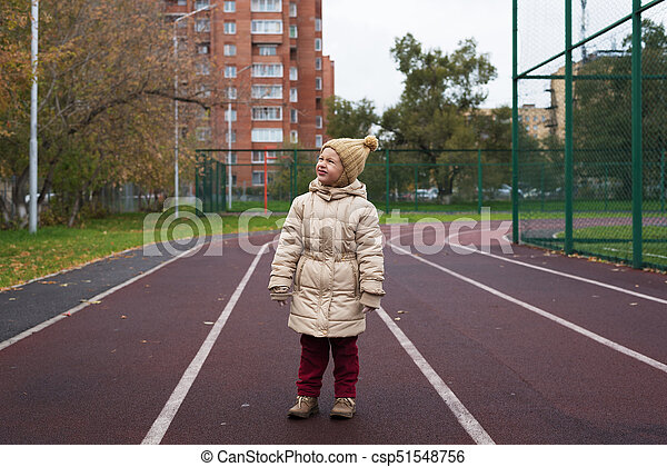 Little girl posing on a running track - csp51548756