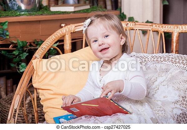 Little girl reading book - csp27427025