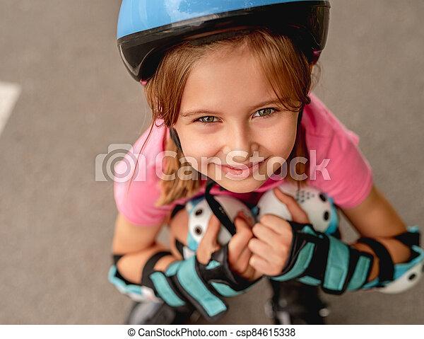 Little girl roller on road background - csp84615338