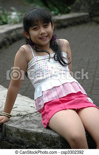 Little girl sit down in park. Little asian girl sit down ...