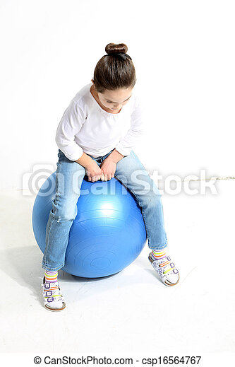 Little girl sitting on the ball - csp16564767