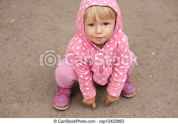 little girl sitting on the ground - csp12422863