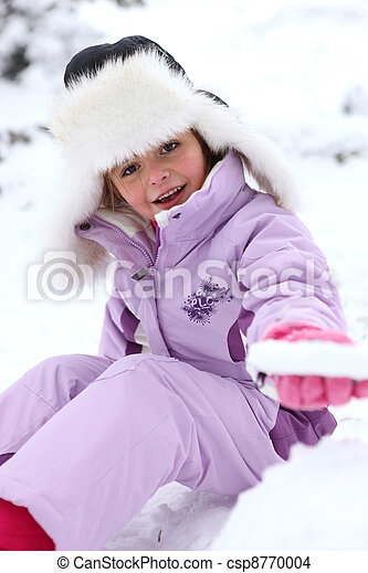 Little girl sitting on the snow - csp8770004