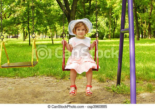 little girl sitting on the swing - csp3960885