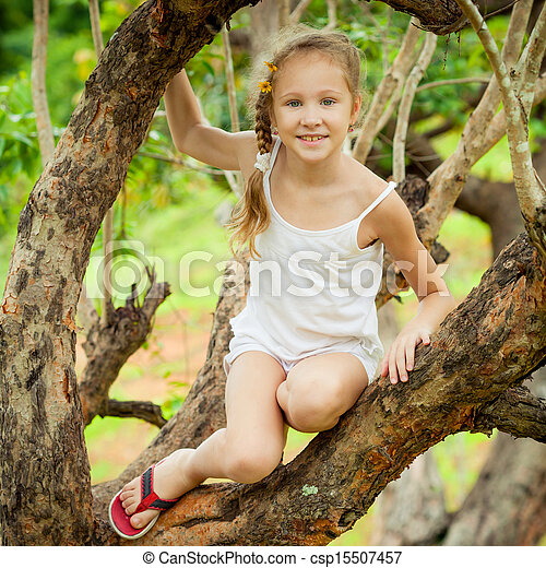 little girl sitting on the tree - csp15507457