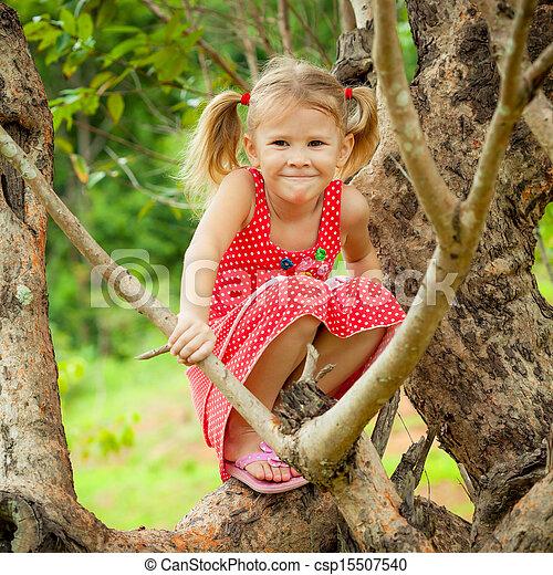 little girl sitting on the tree - csp15507540