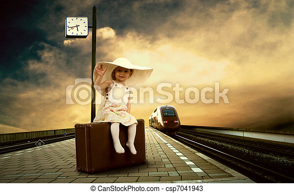 Little girl sitting on vintage baggage on the train platform of railway station - csp7041943