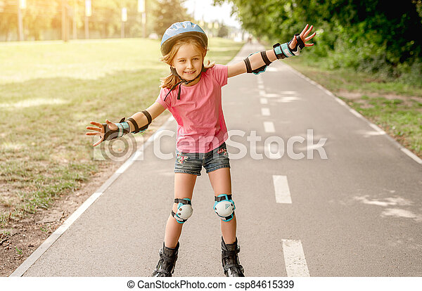 Little girl skating on roller blades - csp84615339