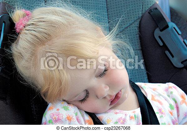 Little girl sleeping in car seat. Little caucasian girl sleeping in ...