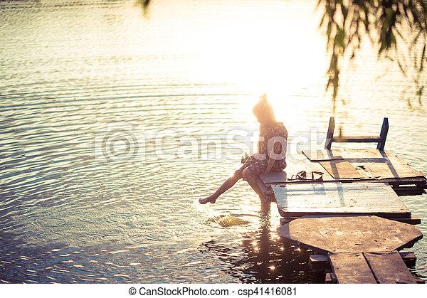little girl splashing at the lake - csp41416081