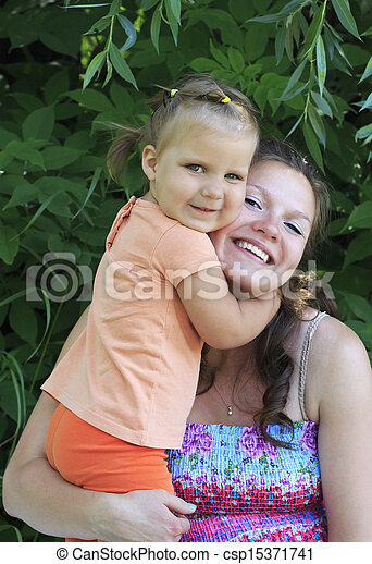 Little girl tenderly embraces his mother. - csp15371741