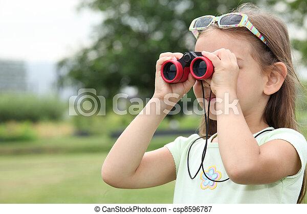 little girl watching through binoculars - csp8596787