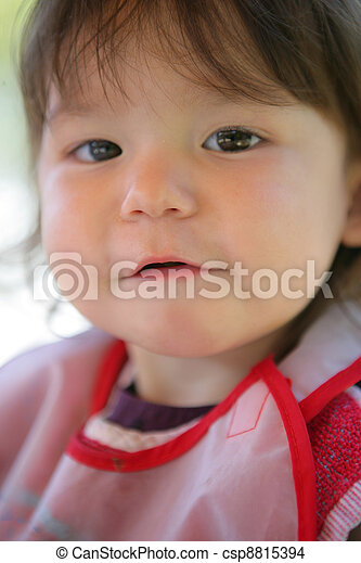 Little girl wearing a bib - csp8815394