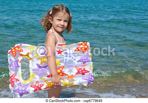little girl with airbed - csp6779649