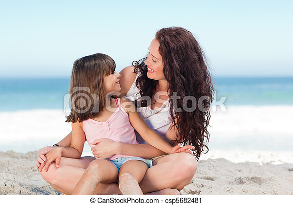Little girl with her mother at the beach - csp5682481