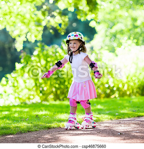 Little girl with roller skate shoes in a park - csp46875660