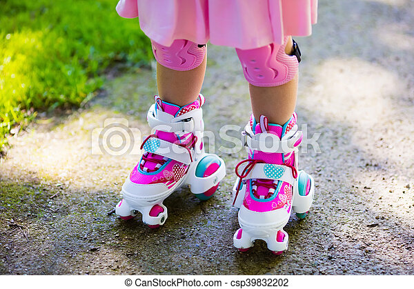 Little girl with roller skate shoes in