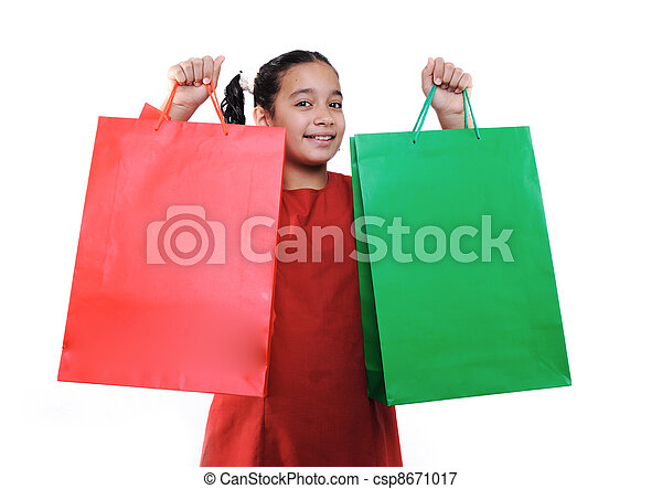 Little girl with shopping bags and boxes, isolated - csp8671017