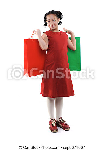 Little girl with shopping bags and boxes, isolated - csp8671067