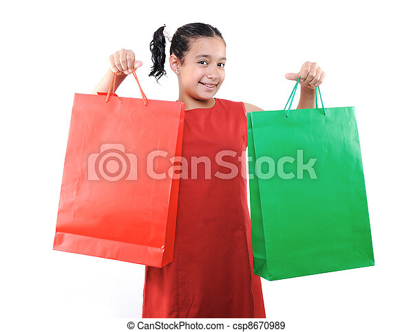 Little girl with shopping bags and boxes, isolated - csp8670989