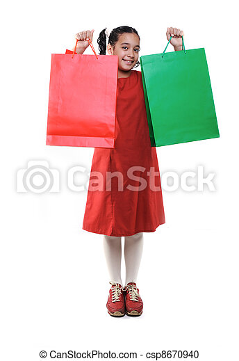 Little girl with shopping bags and boxes, isolated - csp8670940