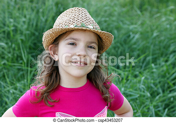 Little girl with straw hat portrait - csp43453207