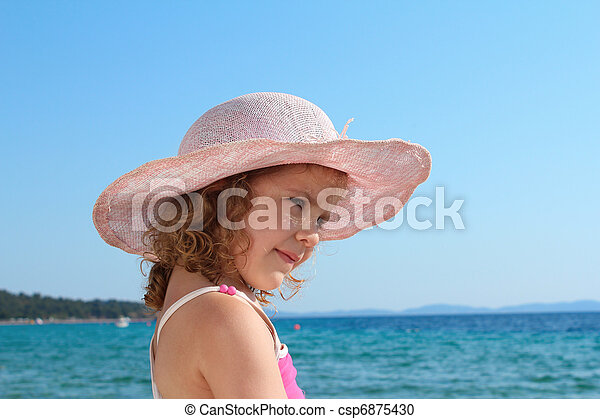 little girl with straw hat - csp6875430