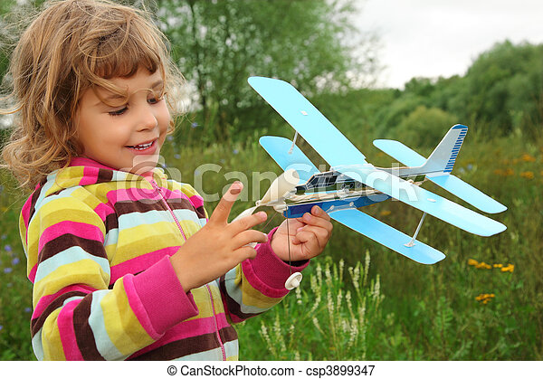 little girl with toy airplane in hands outdoor - csp3899347