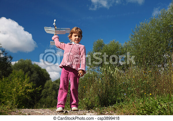 little girl with toy airplane in hands outdoor full body - csp3899418