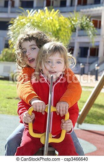 little girls preschool playing park playground - csp3466640