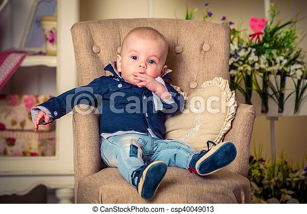 little handsome boy on the sofa - csp40049013