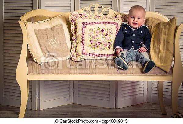 little handsome boy on the sofa - csp40049015