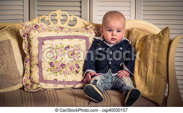 little handsome boy on the sofa - csp40030157