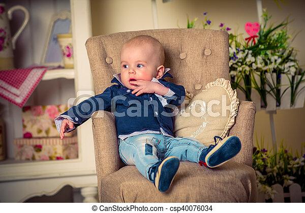 little handsome boy on the sofa - csp40076034