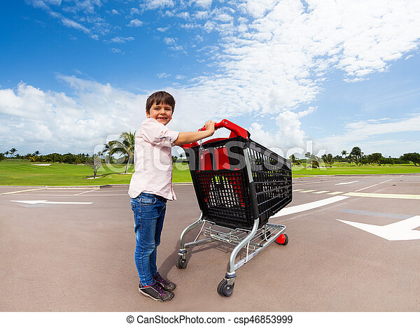 fcd6559f74e0 Little helper pushing supermarket shopping cart