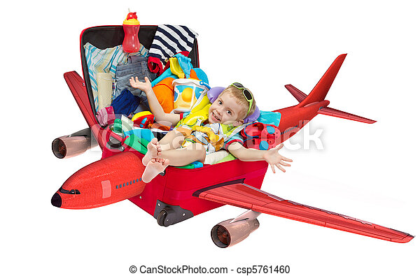Little kid flying in travel suitcase packed for vacation  - csp5761460