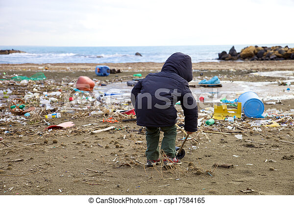 Little kid playing on beach with dirt disaster and danger - csp17584165