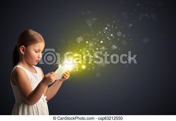 Little kid playing on sparkling tablet - csp63212550