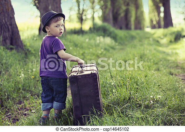Little man leaving home with huge luggage - csp14645102