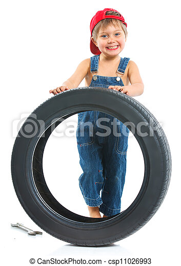 Little mechanic with a tire - csp11026993