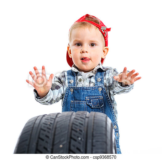 Little mechanic with a tire - csp9368570