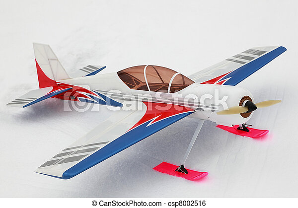 Little model of radio-controlled airplane stands on to snow - csp8002516