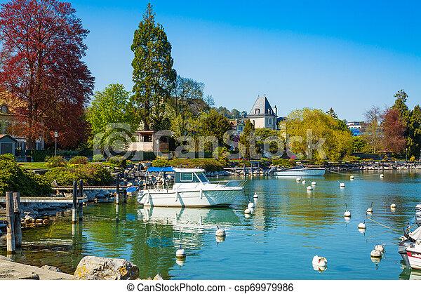Little port on Geneva Lake in Lausanne city - csp69979986