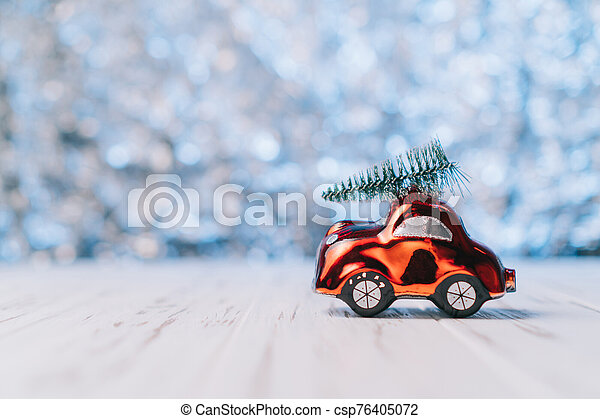 Little red toy car carries a Christmas tree - csp76405072