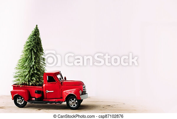Little red toy car with green Christmas tree. - csp87102876