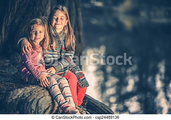Little Sisters at the Lake - csp24489136