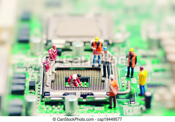 Little workers repairing motherboard. Technology concept - csp19449577
