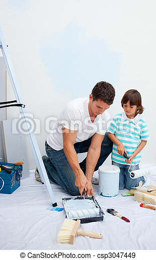 Lively Father and his son painting in their new house - csp3047449