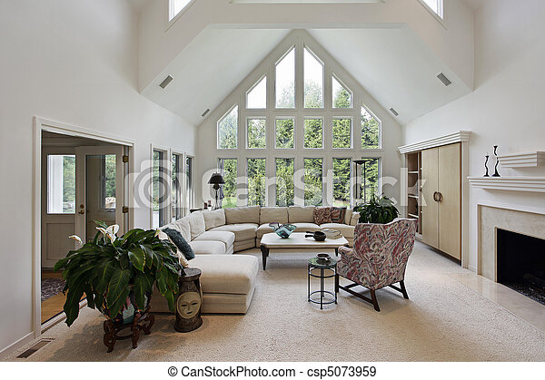 Living room with floor to ceiling windows - csp5073959